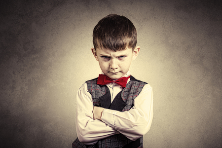 Photo for Stubborn,sad,upset  little boy,child  isolated over yellow background.Facial expression - Royalty Free Image