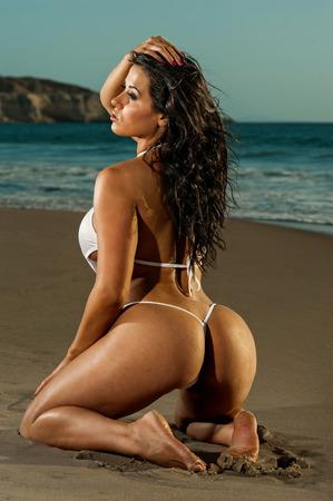Photo for Sexy beach g-string bikini girl - Royalty Free Image