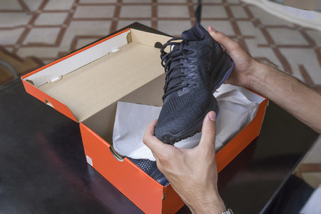 Foto de Opening the box of a new pair of shoes - Imagen libre de derechos