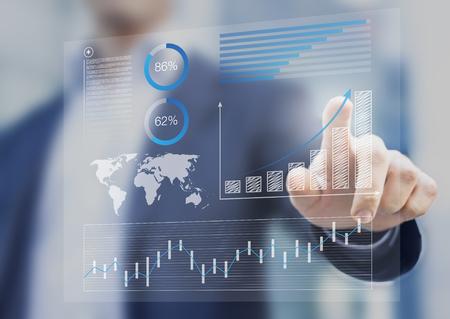 Foto de Businessman touching financial dashboard with key performance indicators - Imagen libre de derechos