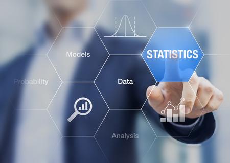Foto de Concept about statistics, data, models and analysis on a transparent screen with a businessman in background - Imagen libre de derechos