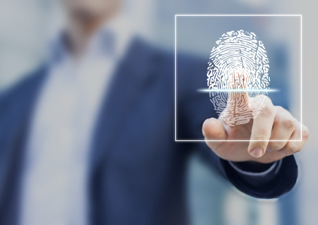 Foto de Fingerprint scan provides security access with biometrics identification, person touching screen with finger in background - Imagen libre de derechos
