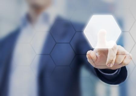 Foto de Person touching an hexagonal button on a digital interface. Concept about technology and choices - Imagen libre de derechos