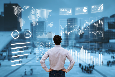 Photo pour Person analyzing a financial dashboard with key performance indicators (KPI) and business intelligence (BI) charts with a business district cityscape in background - image libre de droit