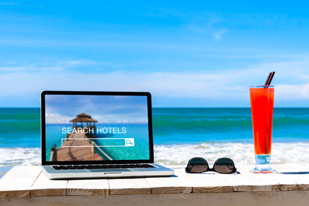 Photo for Search hotels website on computer screen, online booking concept, tropical beach background - Royalty Free Image