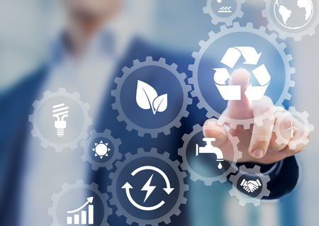 Foto de Sustainable development concept on screen with icons of renewable energy, natural resources preservation, environment protection inside connected gears, business person in background - Imagen libre de derechos