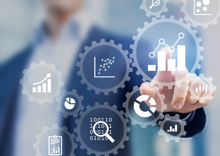 Photo pour Business data analytics process management with a consultant touching connected gear cogs with KPI financial charts and graph, automated marketing dashboard - image libre de droit