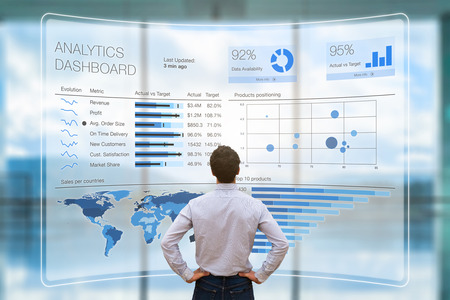 Photo pour Businessman analyzing a business analytics (BA) or intelligence (BI) dashboard on virtual screen showing sales and operations data statistics charts and key performance indicators (KPI) - image libre de droit