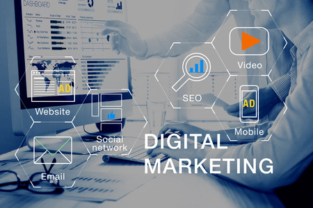 Foto de Concept of digital marketing media (website ad, email, social network, SEO, video, mobile app) with icon, and team analyzing return on investment (ROI) and Pay Per Click (PPC) dashboard in background - Imagen libre de derechos