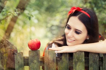 Photo for Snow White with Red Apple Fairy Tale Portrait  - Royalty Free Image
