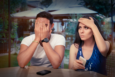 Photo for Young Couple Having Problems with Their Smart Phones  - Royalty Free Image