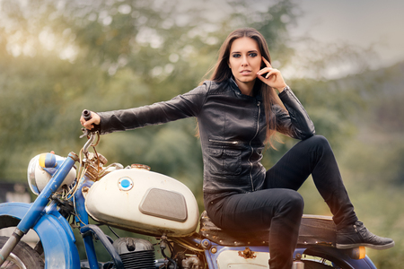 Photo for Biker Girl in Leather Jacket on Retro Motorcycle - Royalty Free Image
