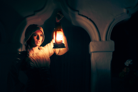 Photo for Medieval Woman with Vintage Lantern Outside at Night - Royalty Free Image