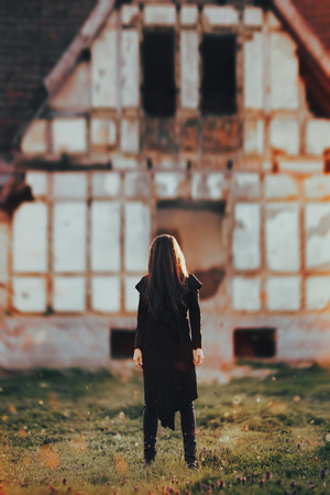 Photo for Evil Ghost in Front of a Horror Haunted Abandoned House - Royalty Free Image