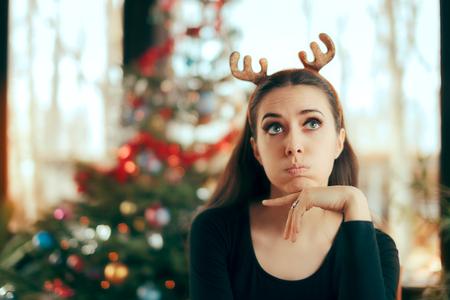 Photo pour Sad Bored Woman Having No Fun At Christmas Dinner Party - image libre de droit