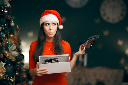 Photo for Sad Woman Hating Receiving Flat Shoes as Christmas Present - Royalty Free Image