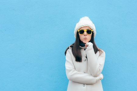 Photo for Funny Woman with Yellow Sunglasses Thinking on Blue Background - Royalty Free Image