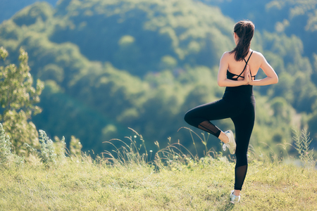 Photo for Fitness Woman Exercising Flexibility and Balance in Beautiful Nature - Royalty Free Image