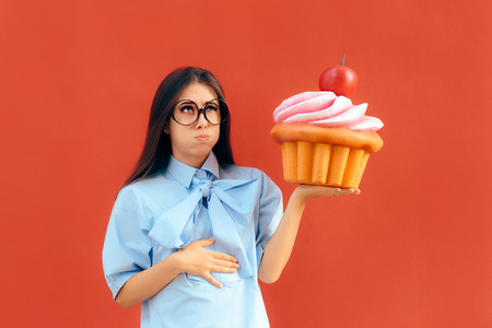 Photo pour Woman Suffering Stomach Ache After Eating Too Much Cupcake - image libre de droit