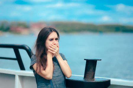 Photo for Sea sick woman suffering motion sickness while on boat - Royalty Free Image