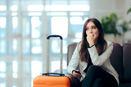 Photo pour Sad Melancholic Woman with Suitcase in Airport Waiting Room - image libre de droit
