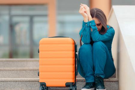 Foto de Sad Woman Leaving with Suitcase after Painful Break-up - Imagen libre de derechos