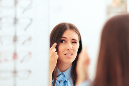 Photo for Woman Having Trouble Putting On Contact Lenses - Royalty Free Image