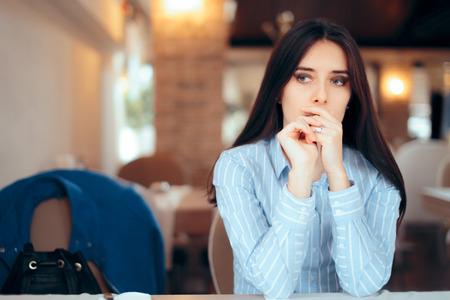 Foto de Sad Woman Removing Wedding Ring Thinking about Divorce - Imagen libre de derechos