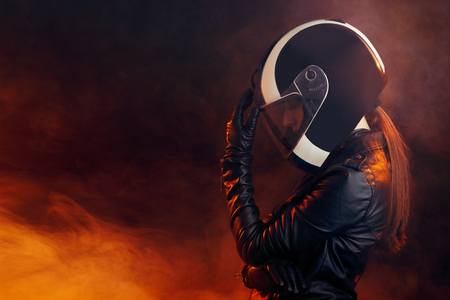 Photo for Biker Woman with Helmet and Leather Outfit Portrait - Royalty Free Image