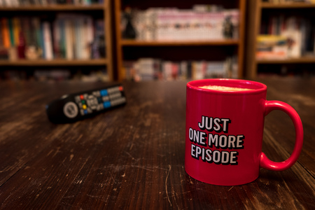 Photo pour Red cup of coffee with inscription Just one more episode and tv remote controller - image libre de droit