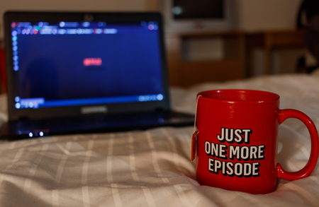 Photo for Watching series with a cup of tea. Inscription Just one more episode. Millennial concept - Royalty Free Image