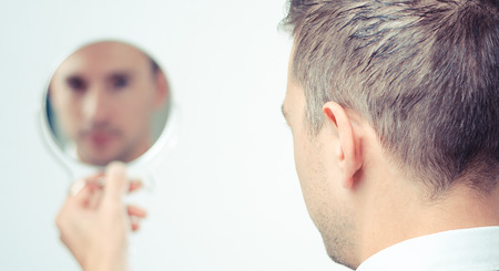 Photo pour Ego business man looking in the mirror and reflecting - image libre de droit