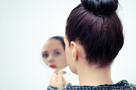Photo pour ego businesswoman looking in the mirror and reflecting - image libre de droit