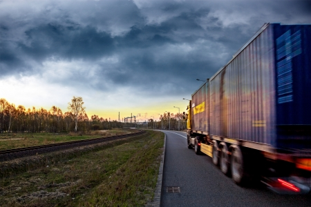 Photo for Truck on the road in stormy day  - Royalty Free Image
