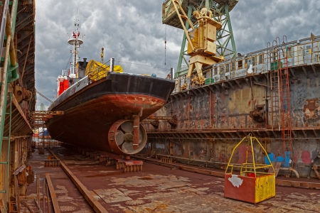 Photo for Ship for repairs in large floating dry dock  - Royalty Free Image