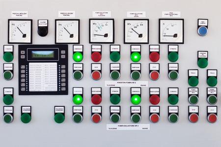 Foto de Many buttons and switches - control panel in a machine. - Imagen libre de derechos