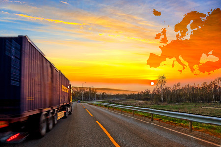 Foto de Truck on road on Europe map background - shipping travel concept. - Imagen libre de derechos