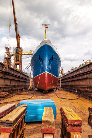 Photo for Big ship at dry dock with its bulbous parts and anchor chain. - Royalty Free Image