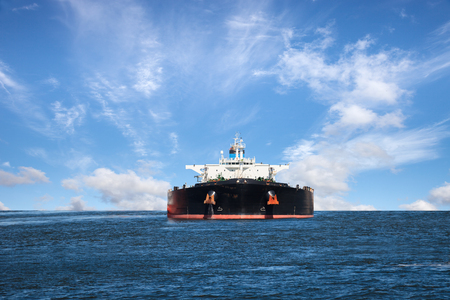 Foto de Oil tanker ship at sea on a background of blue sky. - Imagen libre de derechos