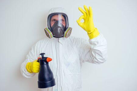 Foto de pest control worker spraying pesticides with sprayer in apartment copy spase white walls background - Imagen libre de derechos