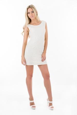Attractive blonde in white short dress