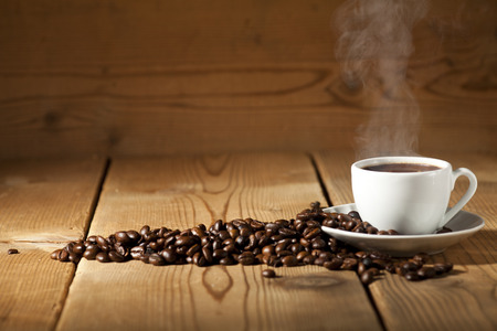Foto für White coffee cup and coffee beans on old wooden background. - Lizenzfreies Bild