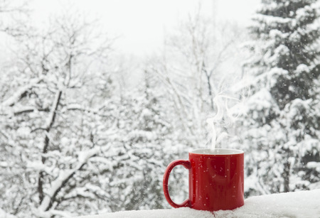 Photo for Red cup of coffee on a beautiful snow winter background. - Royalty Free Image