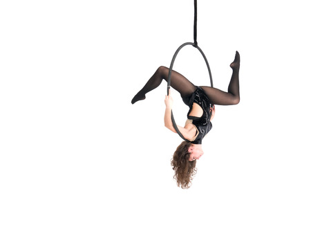 Photo for Young girl posing in an airy ring on a white background. Aerial hoop fly - Royalty Free Image