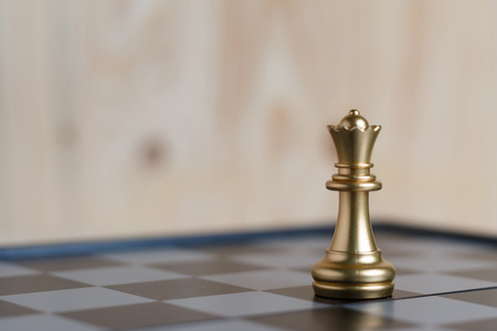 Photo for The gold queen chess set on board is located. Select focus shallow depth of field and blurred background. Concept work - Royalty Free Image