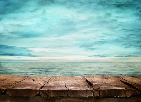 Foto de Wood table and tropical landscape in the background.. Spring or summer abstract nature background.  - Imagen libre de derechos