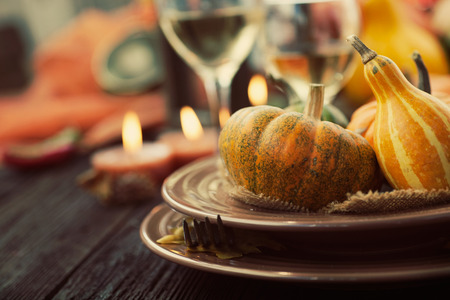 Photo pour Autumn table setting with pumpkins.  Thanksgiving dinner and autumn decoration. - image libre de droit