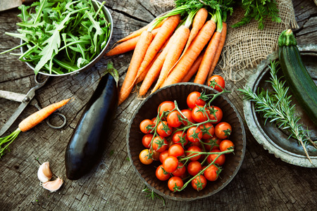 Foto de Fresh organic vegetables. Food background. Healthy food from garden - Imagen libre de derechos