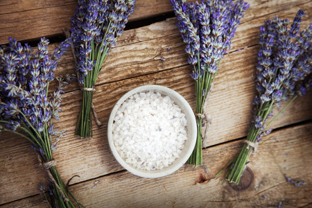 Photo for Spa and wellness setting with lavender flowers, floral water and bath salt. Dayspa nature set - Royalty Free Image