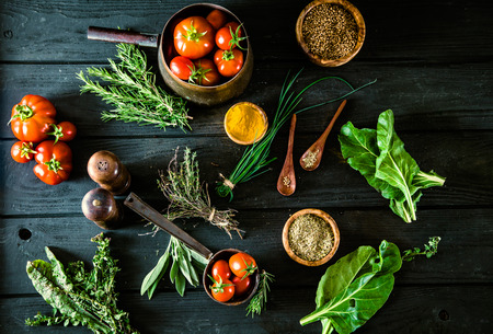 Foto de Vegetables on wood. Bio Healthy food, herbs and spices. Organic vegetables on wood - Imagen libre de derechos
